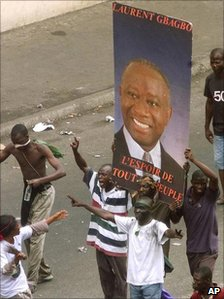 Supporters holding a poster of Laurent Gbagbo in 2000