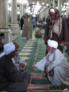 Men gather at a Sufi shrine in Cairo