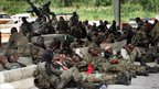 Fighters loyal to Alassane Ouattara rest on the outskirts of Abidjan