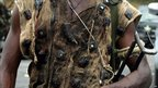 Fighter loyal  to Alassane Ouattara displays traditional hunters' charms. 4 April 2011