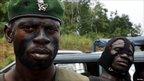 Fighter loyal  to Alassane Ouattara near Abidjan. 4 April 2011