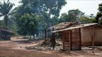 """Picture taken on 29 March 2011 shows damaged houses in Duekoue, in western Ivory Coast, following clashed between forces loyal to internationally recognised Ivory Coast president Alassane Ouattara and his rival""""s troops."""