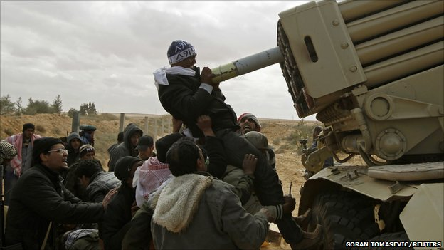 Rebel fighters load a multiple rocket launcher, 9 march 2011