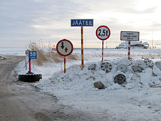 Ice road roadsigns and hubcaps