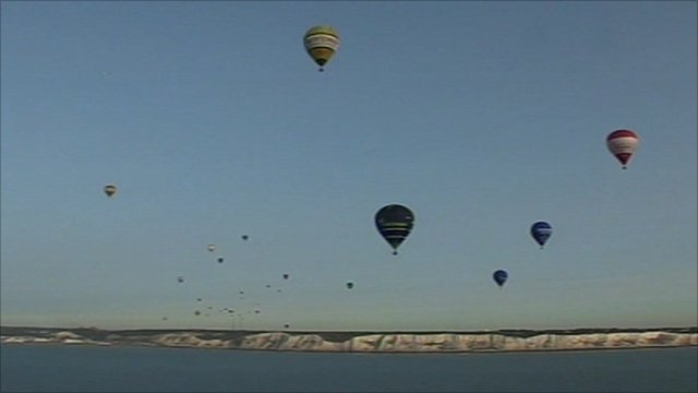 The balloons travel over the white cliffs of Dover