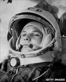 Soviet cosmonaut Yuri Gagarin riding in bus to his Vostok I spaceship, April 12 1961