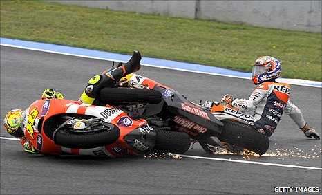 Valentino Rossi and Casey Stoner collide in the Spanish MotoGP