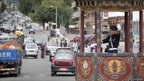 A warden directs traffic in the Bhutanese capital city of Thimphu