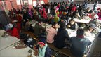 Bhutanese refugees lunch at a camp in Kathmandu before leaving for the United States, December 2010