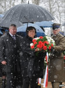 Polish first Lady Anna Komorowska prepares to lay flowers on April 9, 2011 at the monument for the 96 victims of the April 2010 plane crash during a memorial service at the Smolensk aerodrome, the site of the disaster.