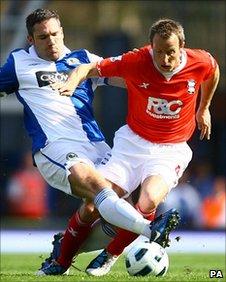 Dunn tackles Bowyer at Ewood Park