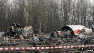 Russian rescuers (R) inspect the wreckage of a Polish government Tupolev Tu-154 aircraft which crashed on 10 April 2010 near Smolensk airport.