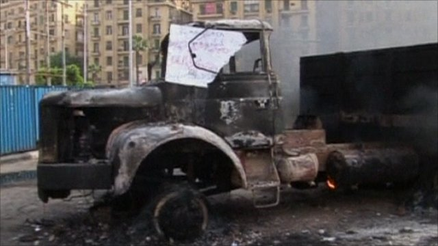 A burnt out lorry in Tahrir Square