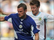 Leicester's Richie Wellens (left) tangles with Burnley's Wade Elliott