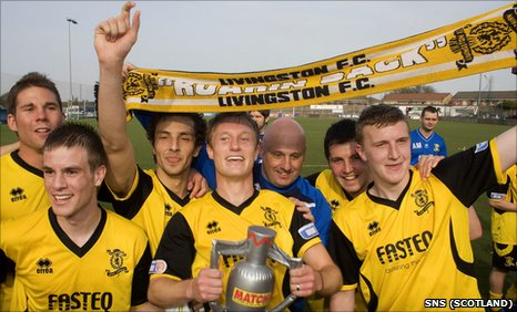 Livingston players celebrate winning the Second Division title