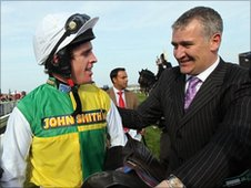 Ballabriggs's jockey Jason Maguire and trainer Donald McCain celebrate