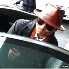 Kenichi Shinoda gets into a car after arriving at the train station in Kobe, western Japan on April 9, 2011