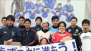 "On 4 April Dai Saito (pictured centre in white) met players and parents of ""Footboze"", the side he used to coach"