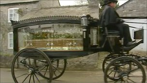 Brynle Williams&#039; coffin passes in a horse-drawn carriage