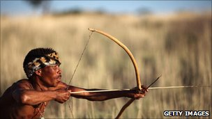 San bushman of Botswana with bow and arrow