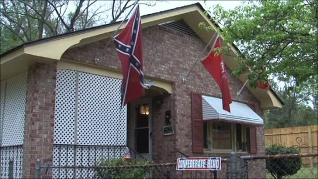 Confederate flag hangs from house