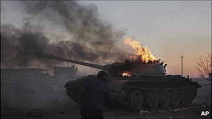 Libyan tank burns after being hit in a Nato air strike (10 April 2011)