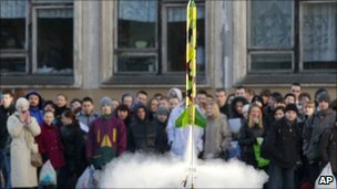 Children watch a model rocket blasting off during a celebration of the 50th anniversary of the Yuri Gagarin's first manned flight into space at a school in St Petersburg, Russia