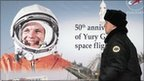 A man passes a portrait of Yuri Gagarin in Moscow on 11 April 2011