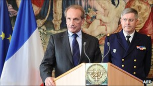 French Defence Minister Gerard Longuet (L) speaks near CEMA admiral Edouard Guillaud during a press conference on April 11, 2011 in Paris