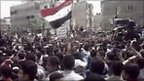 Demonstrators at a funeral in the Damascus suburb of Douma (Still image from video)