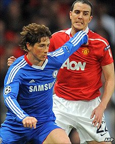 Chelsea striker Fernando Torres battles with Manchester United defender John O'Shea