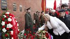Russians lay flowers at Gagarin's grave in the Kremlin wall in Moscow on 12 April 2011