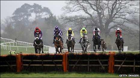 General shot of horses preparing to clear a hurdle at Taunton