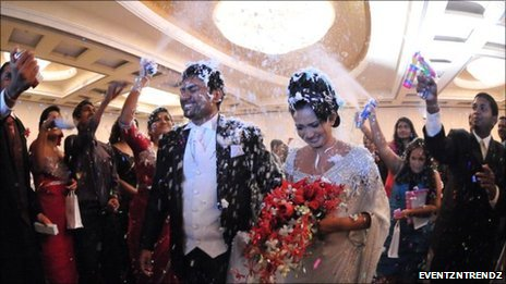 Wedding couple showered with confetti