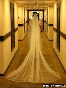 Bride in the hallway with view of her train