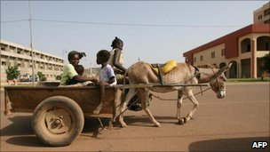 Horse cart going through urban Burkina Faso