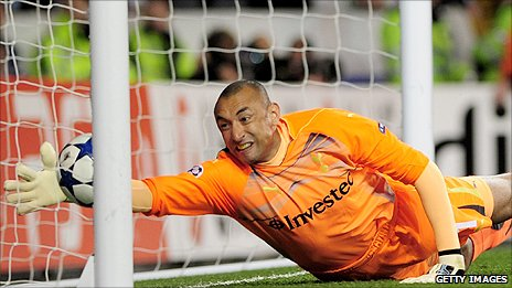 Heurelho Gomes fails to claw the ball away after his error from Cristiano Ronaldo's shot