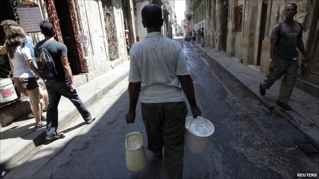Man with buckets of water