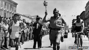 The Torch is carried by a Bersagliere in Bari