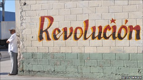File photograph of a wall painted with the word Revolution in Havana, Cuba