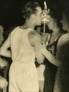 Frank Verge carrying the torch in 1948