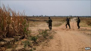 Burundian army soldiers patrol on a road near Rukoko where violence broke out in 2010