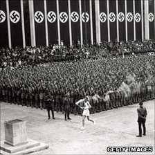 The torch is carried into the stadium in Berlin, 1936