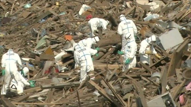 Japanese crews searching through rubble