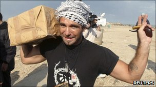 File photo of Vittorio Arrigoni holding aid at Gaza seaport in October 2008