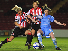 Magan Harris and Leandra Little of Lincoln Ladies battle with Lyndsey Cunningham of Doncaster Rovers Belles
