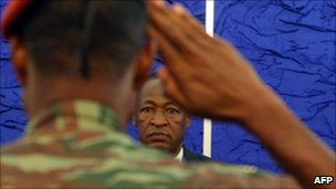 A picture taken on April 1, 2011 show a soldier saluting as Burkina Faso President Blaise Compaore meets armed forces representatives