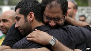 Relatives grieve at the funeral of Karim Fakhrawi, 13 April in Manama