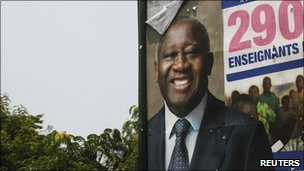 An election billboard showing ousted former president Laurent Gbagbo in Abidjan April 14, 2011