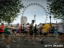 London Marathon competitors run past the London Eye